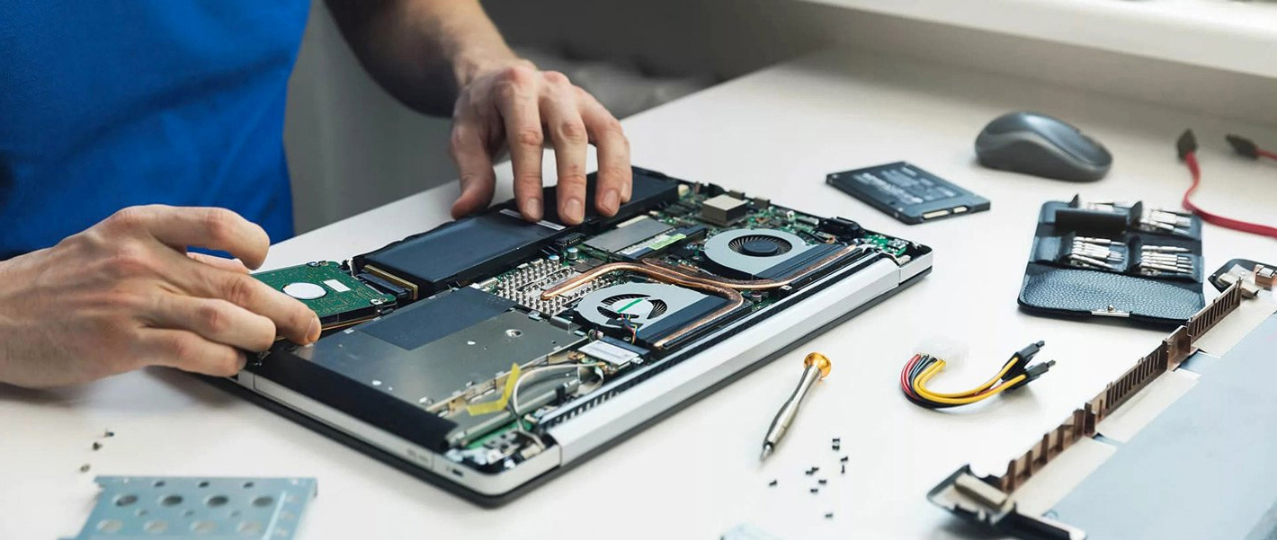 experienced technician working on computer repair