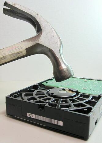 hammer hitting hard drive disk
